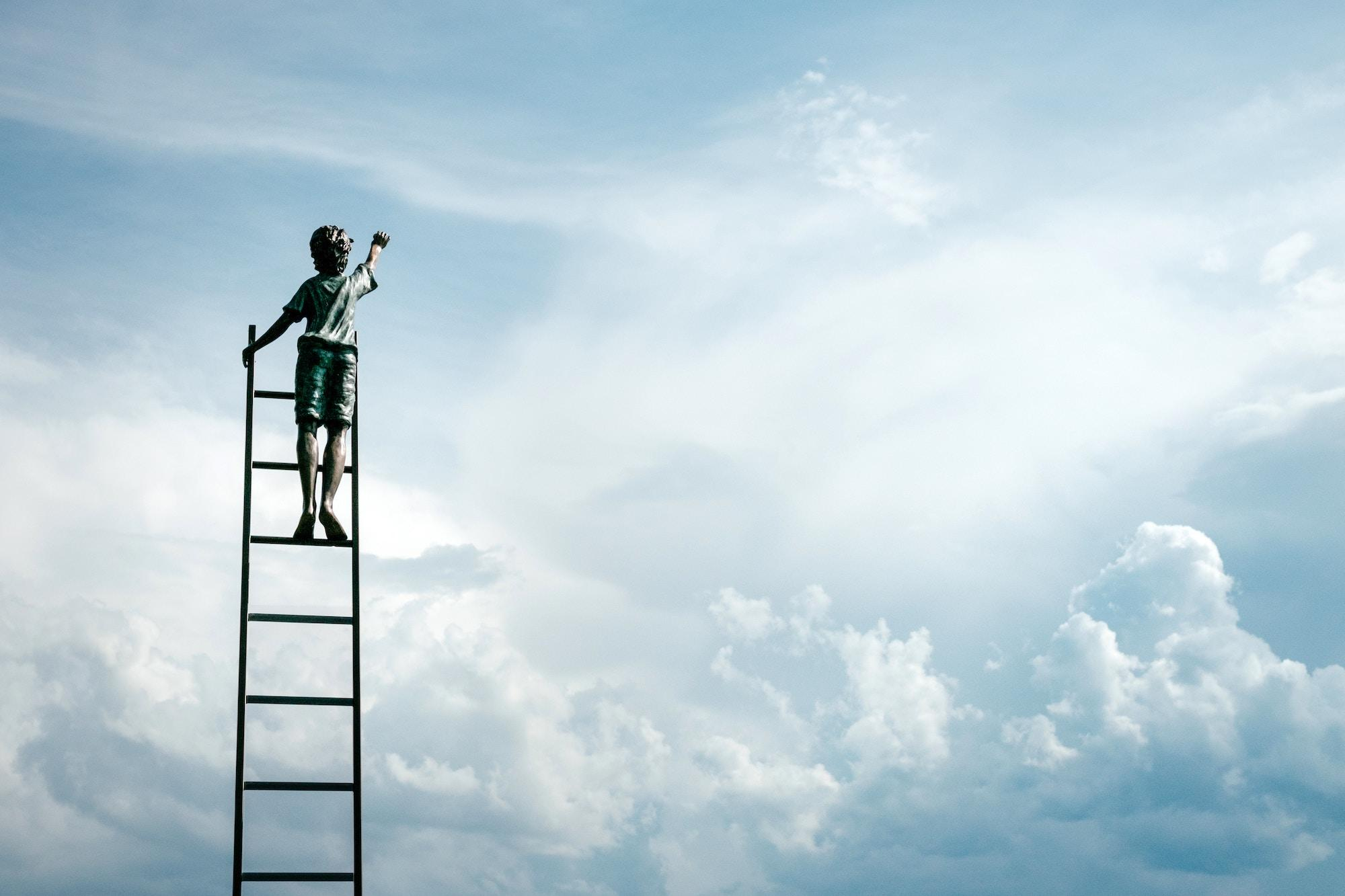 Boy dreamer on top of ladder as symbol of individual sucess