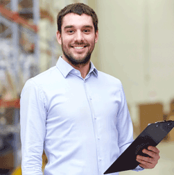 Man smiling and holding a clipboard