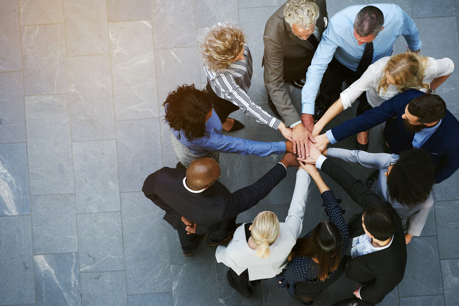 Diverse team with their hands together