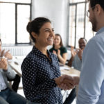 Boss shaking hands with promoted employee